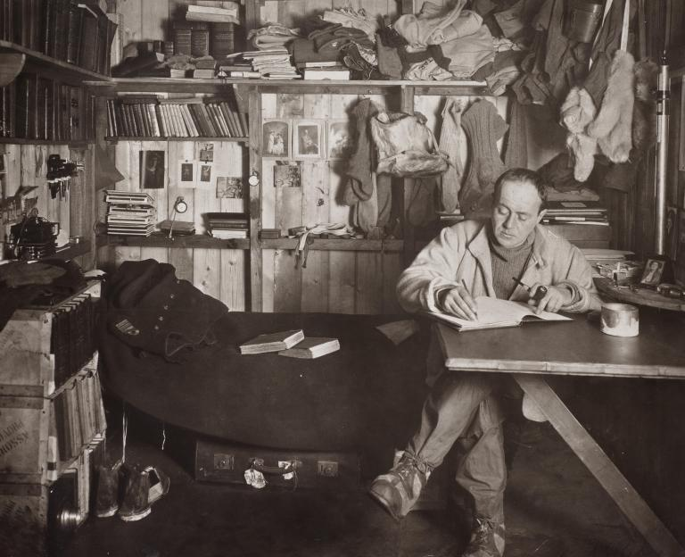 Robert_Falcon_Scott_in_the_Cape_Evans_hut,_October_1911.jpg